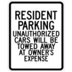 Traffic Sign RESIDENT PARKING UNAUTHORIZED CARS WILL BE TOWED AWAY